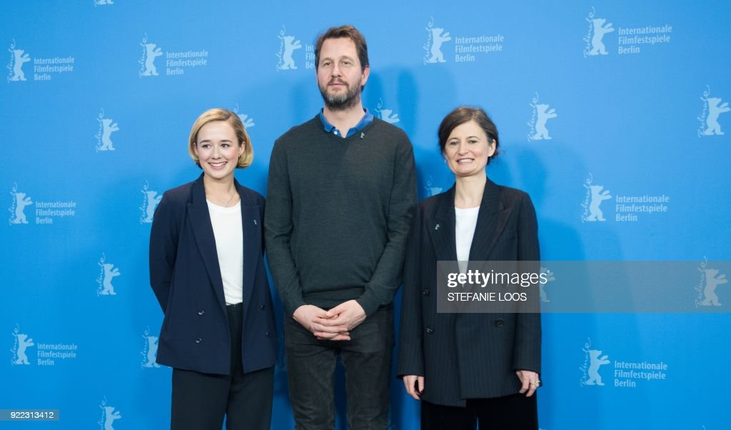 Danish actress Alba August, Norwegian actor Henrik Rafaelsen and Danish film director Pernille Fischer Christensen pose during the photo call for the film 'Becoming Astrid' (Unga Astrid) presented in the 'Berlinale special gala' category during the 68th edition of the Berlinale film festival in Berlin on February 21, 2018. / AFP PHOTO / Stefanie Loos