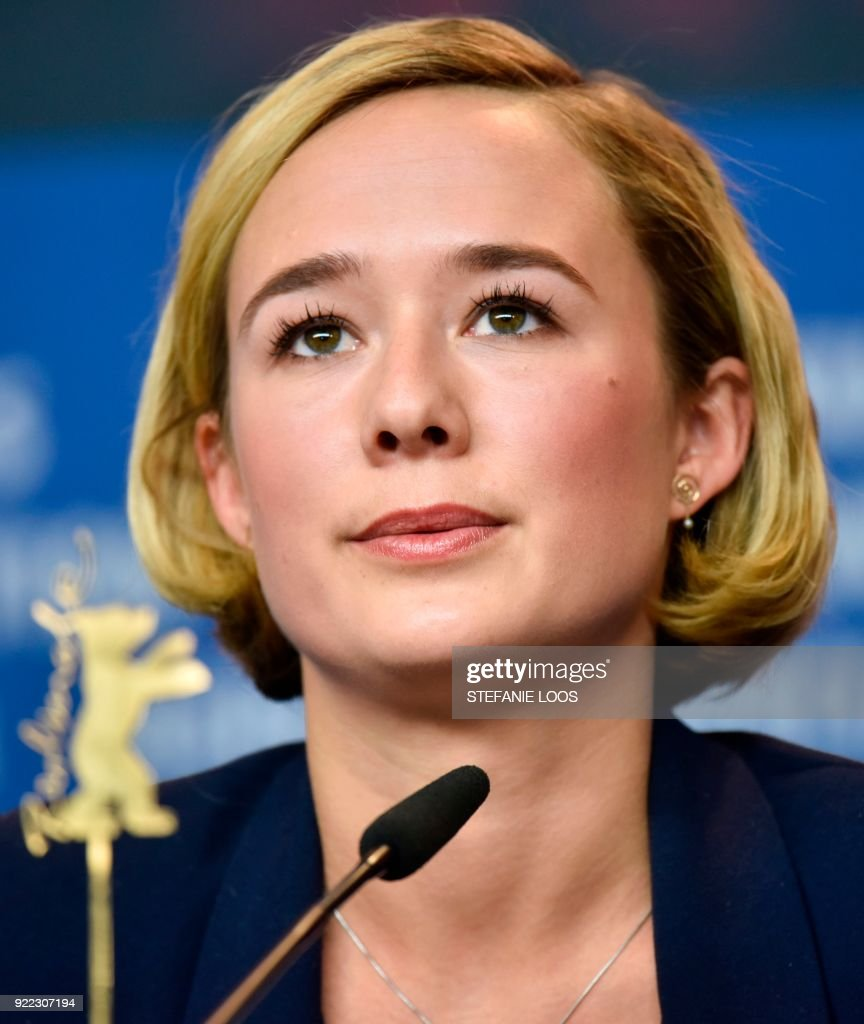 Danish actress Alba August speaks during a press conference to present the film 'Becoming Astrid' (Unga Astrid) presented in the 'Berlinale special gala' category during the 68th edition of the Berlinale film festival in Berlin on February 21, 2018. / AFP PHOTO / Stefanie Loos