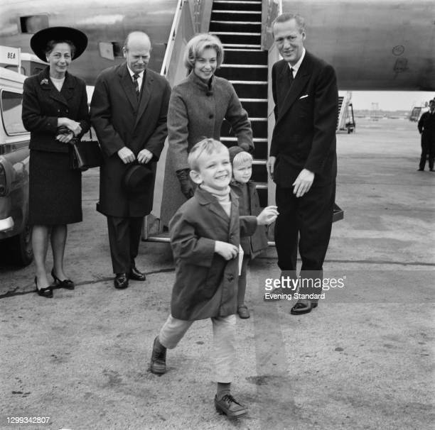 Danish actress Helle Virkner , the wife of Danish Prime Minister Jens Otto Krag, arrives at London Airport, UK, with her children, Jens Christian and...