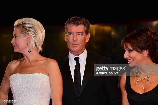 Danish actress Trine Dyrholm Irish actor Pierce Brosnan and film director Susanne Beer arrive for the screening of Den Skaldede frisor during the...