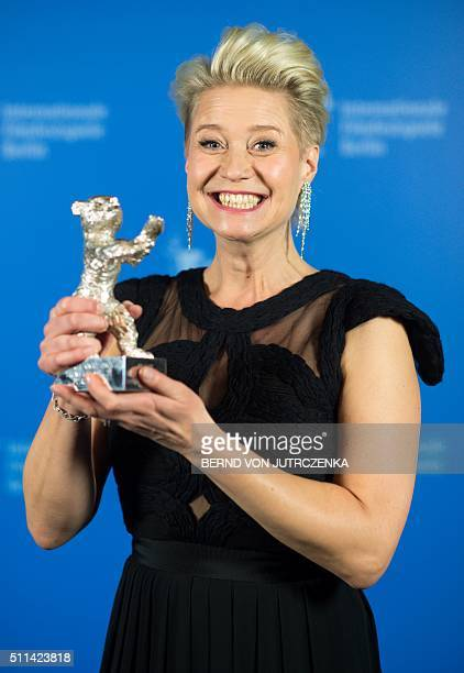 Danish actress Trine Dyrholm poses with her Silver Bear trophy for best actress award during a photocall at the awards ceremony of the 66th...