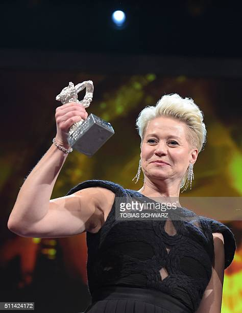 Danish actress Trine Dyrholm poses with the Silver Bear for best actress during the awards ceremony of the 66th Berlinale, Europe's first major film...