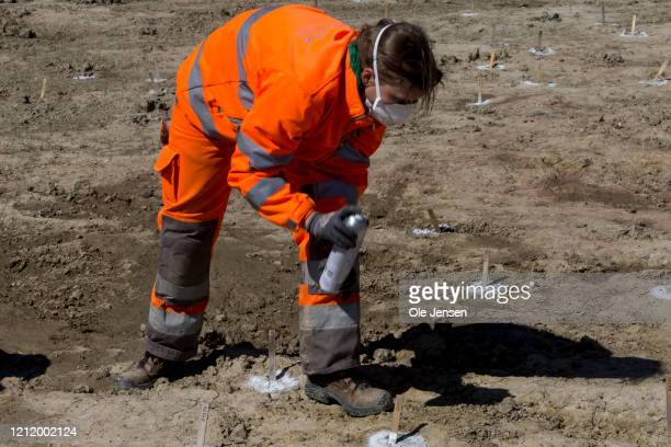 Danish archaeologist marks finds at the one-kilometer-long excavation pit that revealed a 2,000-year-old Iron Age defence belt at the Fehmarnbelt...