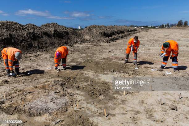 Danish archaeologists mark finds at the one-kilometer-long excavation pit that revealed a 2,000-year-old Iron Age defence belt at the Fehmarnbelt...
