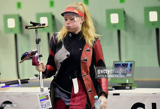 Danish Astrid Steffensen reacts as she finished the race in AUDI Arena of Gyor on February 26 2016 after the qualification round of 10m air rifle...