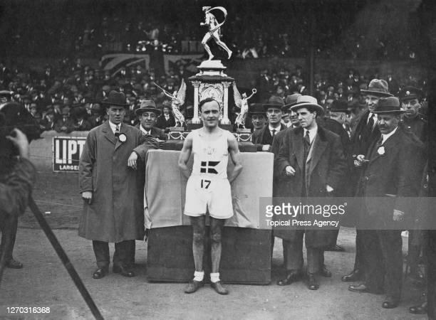 Danish athlete Aksel Georg Jensen of Copenhagen with his trophy at the Polytechnic Marathon, UK, June 1923.