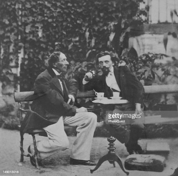 Danish author Hans Christian Andersen at an outdoor table with an unidentified man 19th century