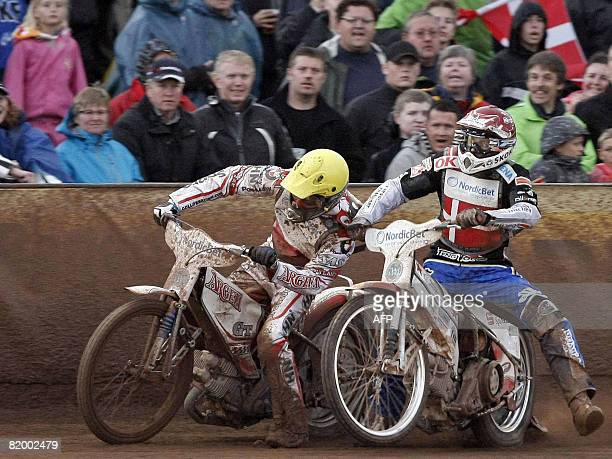 Danish Bjarne Pedersen and Polish Tomasz Gollob compete for the first place in a heat during the Speedway World Cup on July 19 2008 in Vojens western...