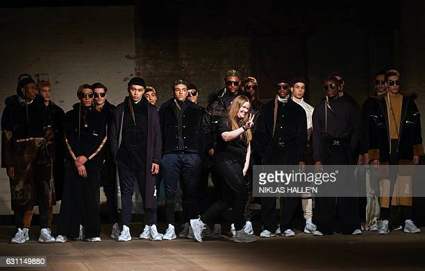 Danish born fashion designer Astrid Andersen greets the crowd after showcasing her collection the second day of the Autumn/Winter 2017 London Fashion...