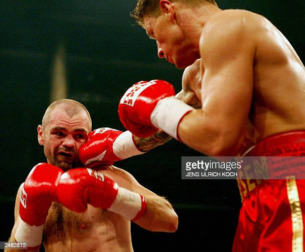 Danish challenger Mads Larsen exchanges punches with German super middleweight IBF and WBA title holder Sven Ottke at Erfurt's Messehalle 06...