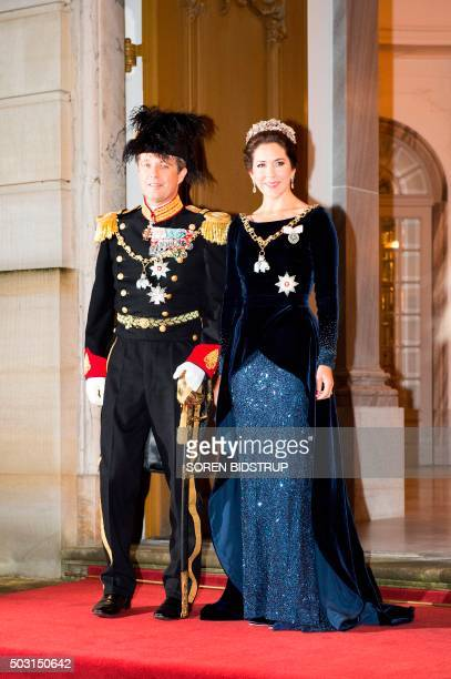 Danish Crown Prince Frederik and Crown Princess Mary arrive to the New Year's reception at the royal palace Amalienborg in Copenhagen January 1,...