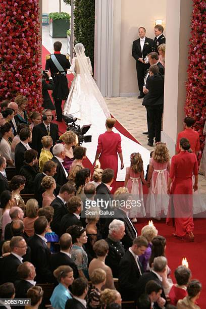 Danish Crown Prince Frederik and Crown Princess Mary Donaldson exit Copenhagen Cathedral on May 14 2004 in Copenhagen Denmark The romance began in...