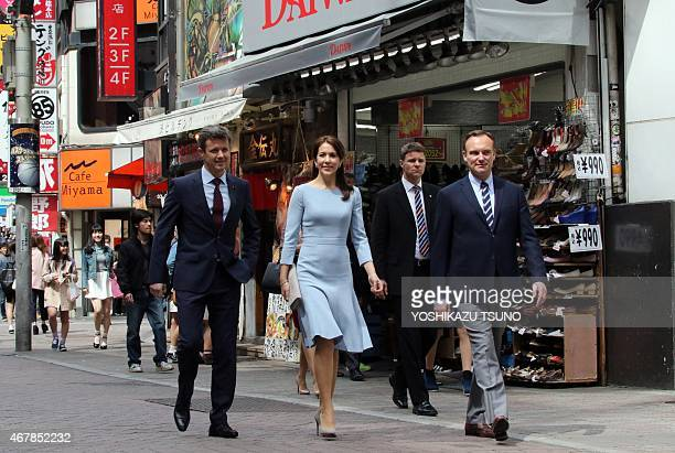 Danish Crown Prince Frederik and Crown Princess Mary enjoy a stroll through Tokyo's Shibuya district on March 28, 2015. The Danish royal couple are...