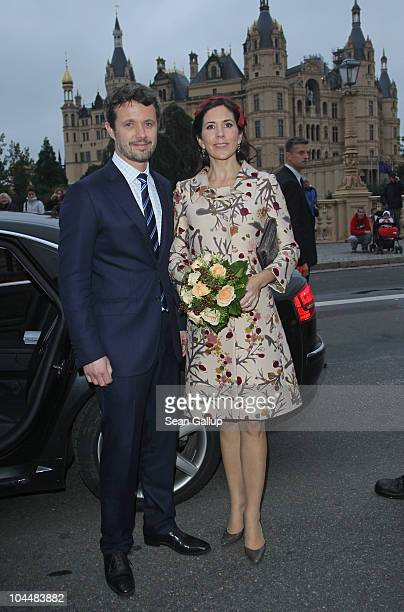 Danish Crown Prince Frederik and Danish Crown Princess Mary who is pregnant with twins stand outside Schloss Schwerin palace on September 27 2010 in...