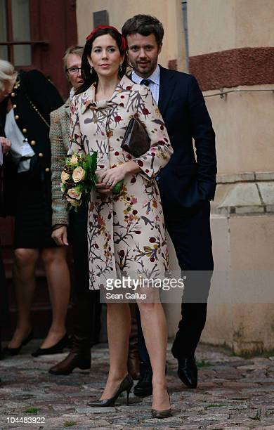 Danish Crown Prince Frederik and Danish Crown Princess Mary who is pregnant with twins emerge from the Schwerin State Museum on September 27 2010 in...