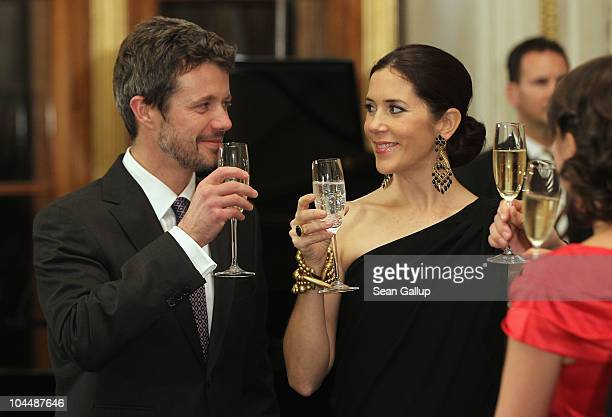 Danish Crown Prince Frederik and Danish Crown Princess Mary who is pregnant with twins attend a reception and dinner in their honour at Schloss...