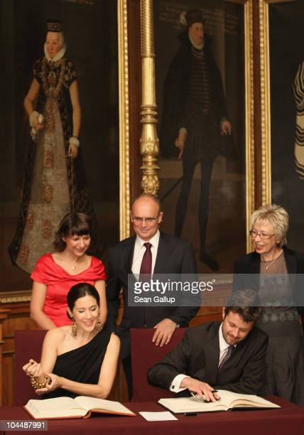 Danish Crown Prince Frederik and Danish Crown Princess Mary who is pregnant with twins sign guest books as MecklenburgWestern Pomerania Governor...