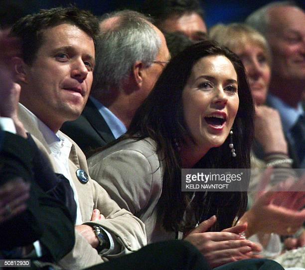 Danish Crown Prince Frederik and his Australian fiancee Mary Donaldson attend the Rock'n'Royal concert at Copenhagen's Parken Stadium 07 May 2004...