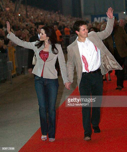 Danish Crown Prince Frederik and his Australian fiancee Mary Donaldson wave as they leave the Rock'n'Royal concert at Copenhagen's Parken Stadium 07...