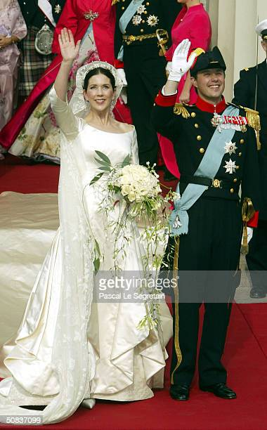 Danish Crown Prince Frederik and his bride Crown Princess Mary leave Copenhagen Cathedral after their wedding ceremony May 14 2004 in Copenhagen...