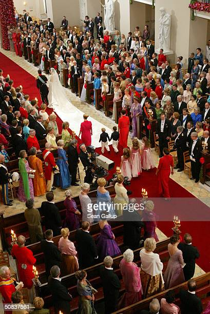 Danish Crown Prince Frederik and his bride Crown Princess Mary walk down the isle of Copenhagen Cathedral after their wedding ceremony on May 14 2004...