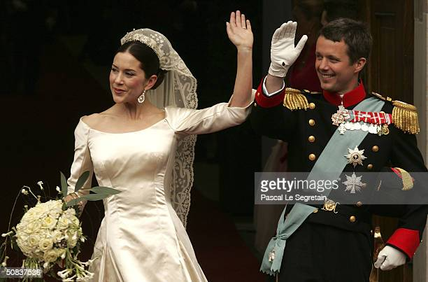 Danish Crown Prince Frederik and his new bride Crown Princess Mary wave as they leave Copenhagen Cathedral after their wedding ceremony on May 14...