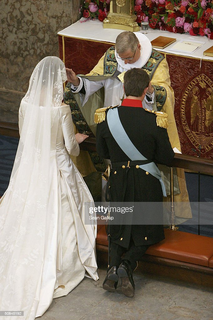 Danish Crown Prince Frederik and Miss Mary Elizabeth Donaldson are married by Bishop Erik Normann Svendsen in Copenhagen Cathedral on May 14, 2004 in Copenhagen, Denmark. The romance began when Donaldson met the heir to one of Europe's oldest monarchies over drinks at the 2000 Sydney Olympics, where he was with the Danish sailing team.