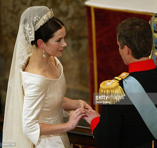 Danish Crown Prince Frederik stands next to his bride Miss Mary Elizabeth Donaldson as they marry in Copenhagen Cathedral May 14 2004 in Copenhagen...