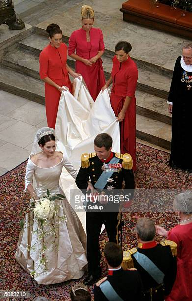 Danish Crown Prince Frederik walks down the isle next to his new bride Princess Mary after they marry in Copenhagen Cathedral May 14 2004 in...