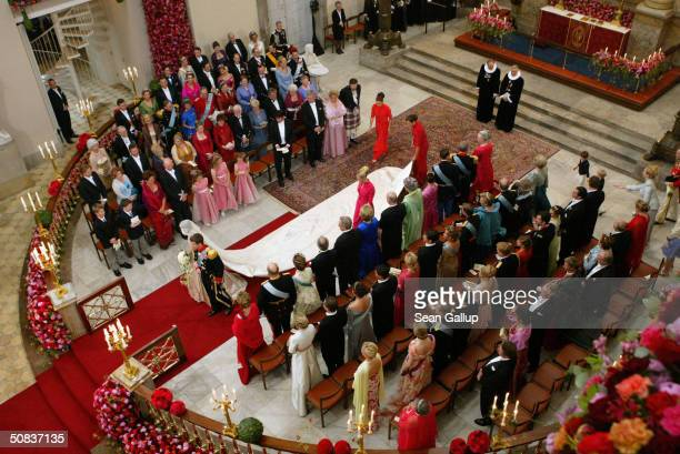 Danish Crown Prince Frederik walks down the isle with his new bride Princess Mary after marrying at the Copenhagen Cathedral May 14 2004 in...