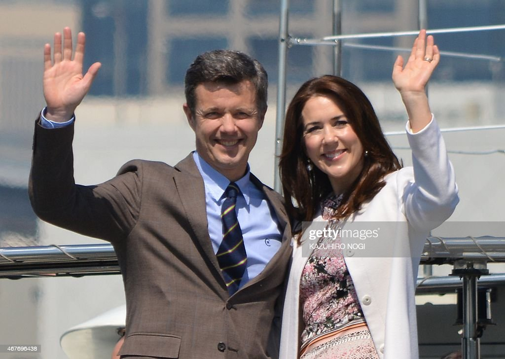 Danish Crown Princess Mary (R) and Crown Prince Frederik (L) wave to the press from a cruise boat during their inspection to the 2020 Tokyo Olympic and Paralympic Games facilities planned sites in Tokyo on March 27, 2015. The Danish royal couple are on a three-day visit to Japan.