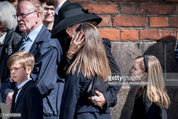 Danish Crown Princess Mary comforts her daughter princess Isabella next to prince Vincent and princess Josephine during the funeral service for the...