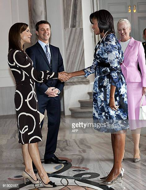 Danish Crown Princess Mary Crown Prince Frederik and Queen Margrethe welcome US First Lady Michelle Obama at Amalienborg Castle in Copenhagen on...