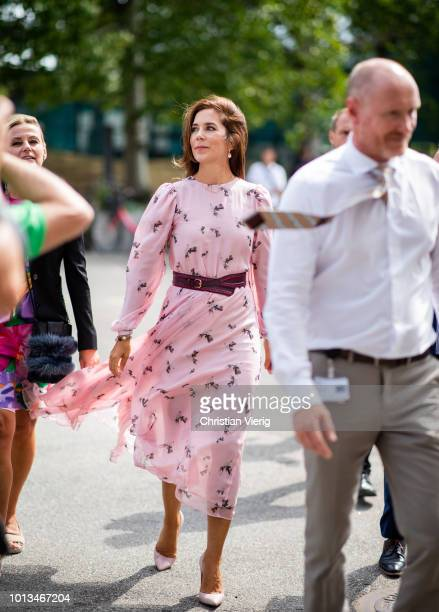 Danish Crown Princess Mary of Denmark Mary Elizabeth Donaldson wearing pink dress with belt is seen outside CIFF fair during the Copenhagen Fashion...