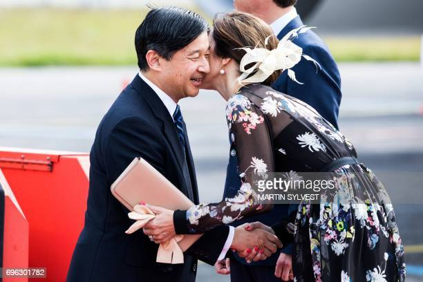 Danish Crown Princess Mary welcomes Japan's Crown Prince Nahurito during a welcoming ceremony in Copenhagen Airport June 15 2017 Japan's Crown Prince...