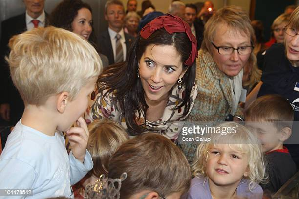 Danish Crown Princess Mary who is pregnant with twins greets children at the Ozeaneum maritime museum and aquarium on September 27 2010 in Stralsund...