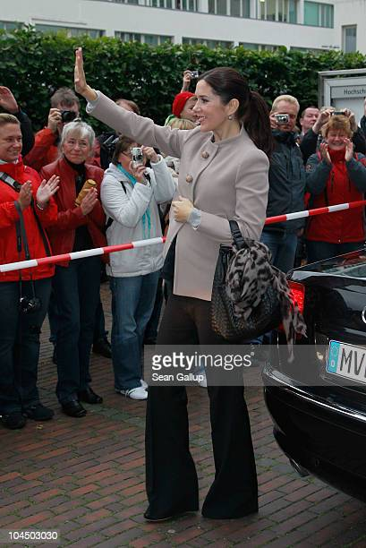 Danish Crown Princess Mary who is pregnant with twins greets onlookers upon her arrival with her husband Danish Crown Prince Frederik at the High...