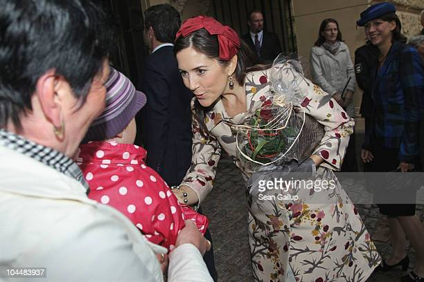 Danish Crown Princess Mary who is pregnant with twins greets well wishers upon her arrival at Schloss Schwerin palace on September 27 2010 in...