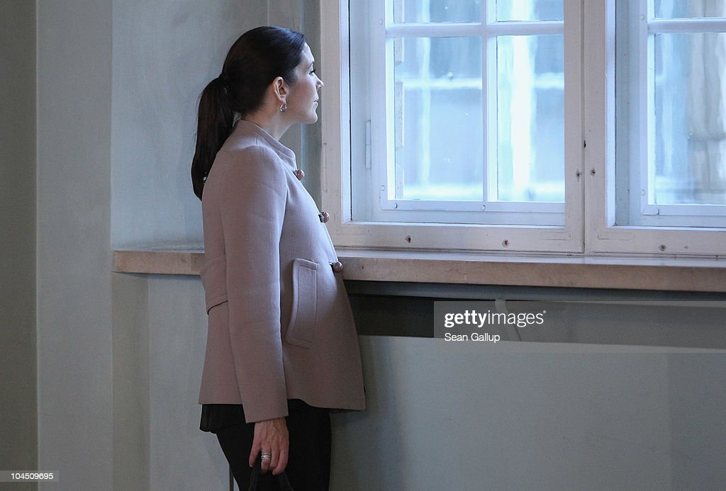 Danish Crown Princess Mary, who is pregnant with twins, pauses to look out of a window while touring Schloss Guestrow palace with her husband Danish Crown Prince Frederik on September 28, 2010 in Guestrow, Germany. Prince Frederik and Princess Mary are on a two-day visit to northern Germany.