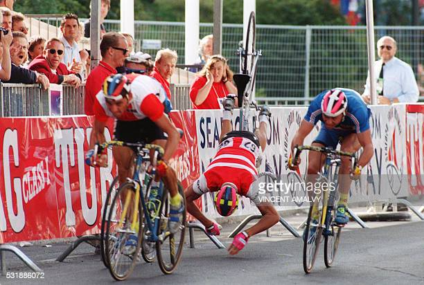 Danish cyclist Lars Michaelsen flies over his bike as he crashes in front of the finish line during the men's amateur individual road race at the...