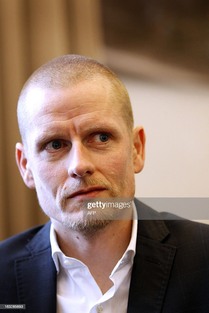 Danish cyclist Michael Rasmussen listens during his appeal trial in a courtroom in Arnhem, on March 7, 2013. Rasmussen is claiming 5.8 million euros (some 7.55 million US dollars) as damages from his former Rabobank team who dismissed him from the 2007 Tour de France, when he was wearing the race leader's yellow jersey, after confusion over his whereabouts when it came to anti-doping tests. Rasmussen admitted in January 2013 that he had used banned drugs between 1998-2010. - belgium out