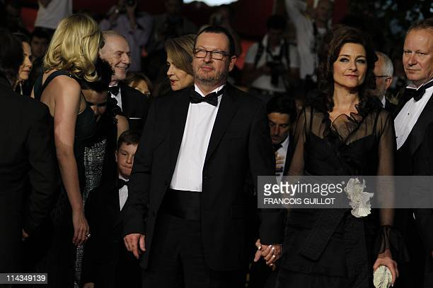 Danish director Lars Von Trier and wife Bente Froge pose on the red carpet before the screening of Melancholia presented in competition at the 64th...