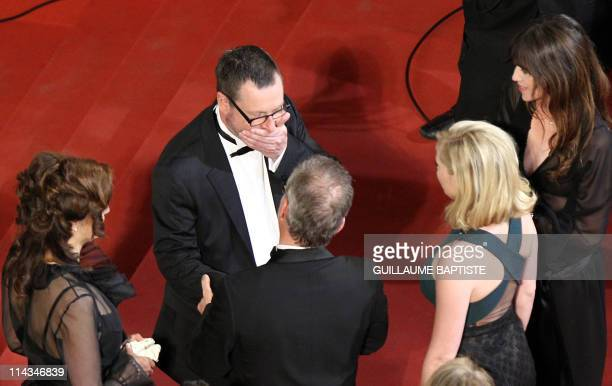 Danish director Lars Von Trier grimaces next to his wife Bente Froge French actress Charlotte Gainsbourg US actress Kirsten Dunst and the General...