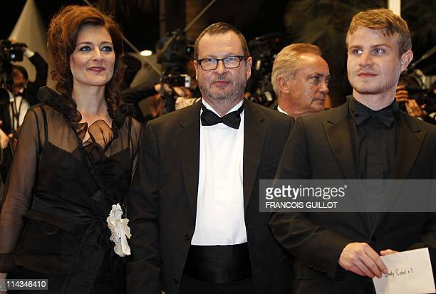 Danish director Lars Von Trier his wife Bente Froge and US actor Brady Corbet pose on the red carpet before the screening of Melancholia presented in...