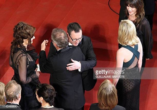 Danish director Lars Von Trier hugs the General Delegate of the festival Thierry Fremaux next to his wife Bente Froge French actress Charlotte...