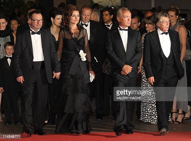 Danish director Lars Von Trier wife Bente Froge German actor Udo Kier and British actor John Hurt pose on the red carpet before the screening of...