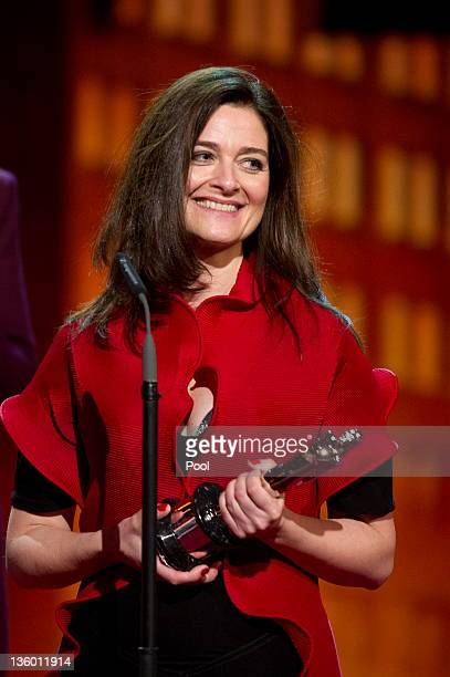 Danish director Lars von Trier's wife Bente Froge holds the 'European Film 2011' award for von Trier's film Melancholia during the 24th European Film...