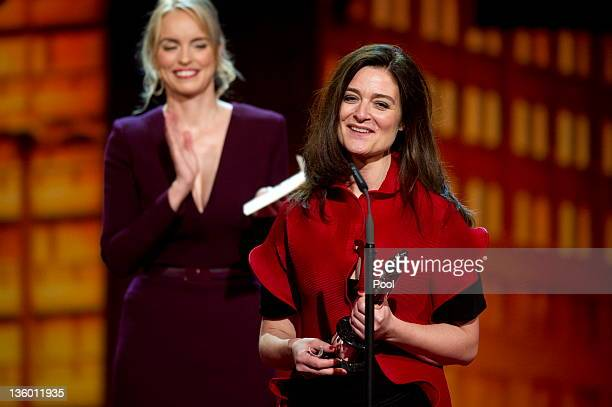 Danish director Lars von Trier's wife Bente Froge is applauded by German actress Nina Hoss after receiving the 'European Film 2011' award for von...