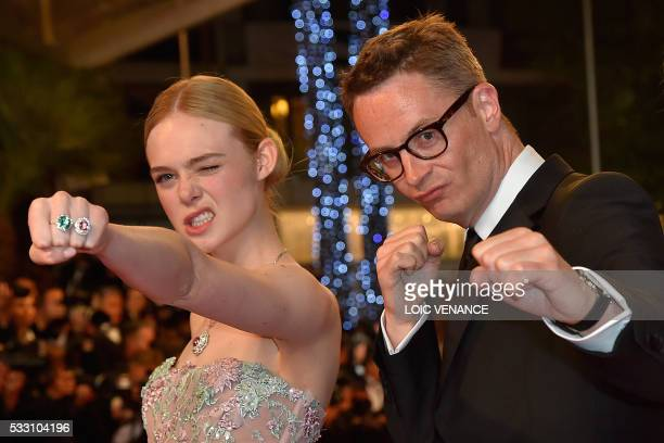 """Danish director Nicolas Winding Refn and US actress Elle Fanning pose as they arrive on May 20, 2016 for the screening of the film """"The Neon Demon""""..."""