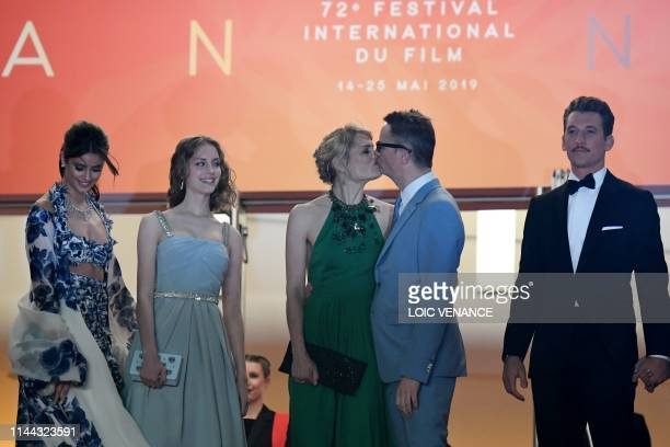 Danish director Nicolas Winding Refn kisses his wife Liv Corfixen as he arrives with US model Taylor Hill , his daughter Lola and US actor Miles...